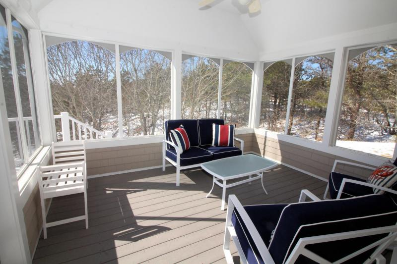 Screen porch is a wonderful spot to relax