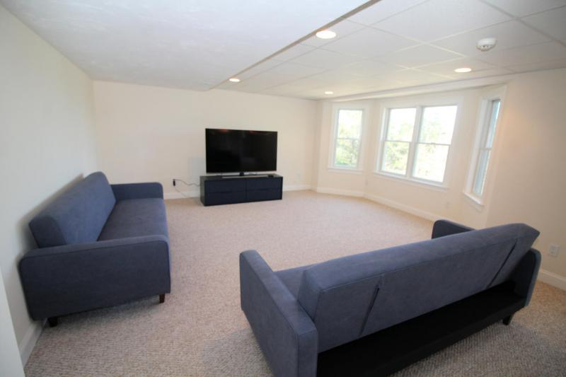Sacious lower level family room has a large flat screen TV