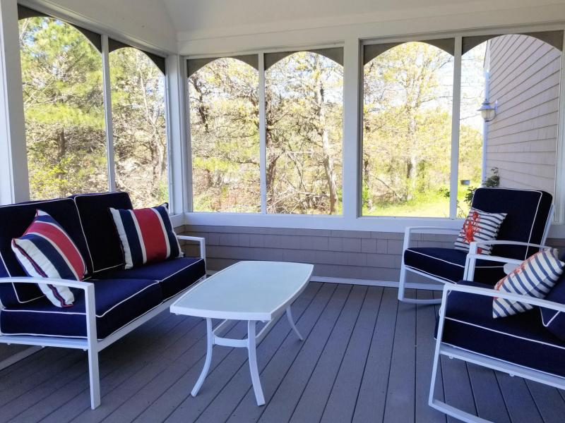 Lounge on the screened porch and keep the bugs at bay