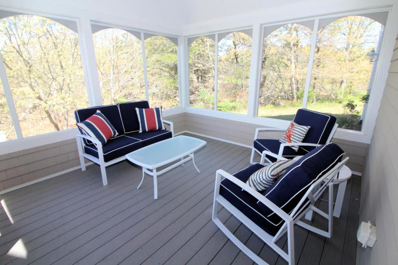 Screened porch perfect for lounging