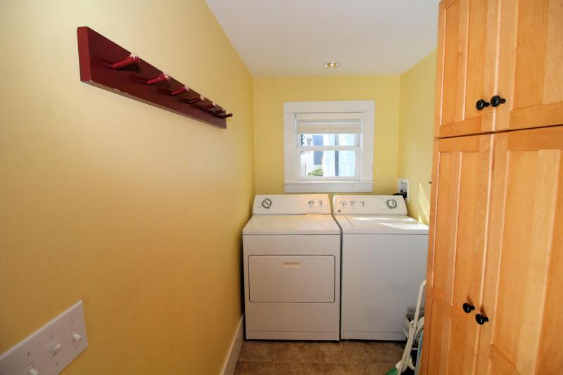 Mud room with washer and dryer off kitchen