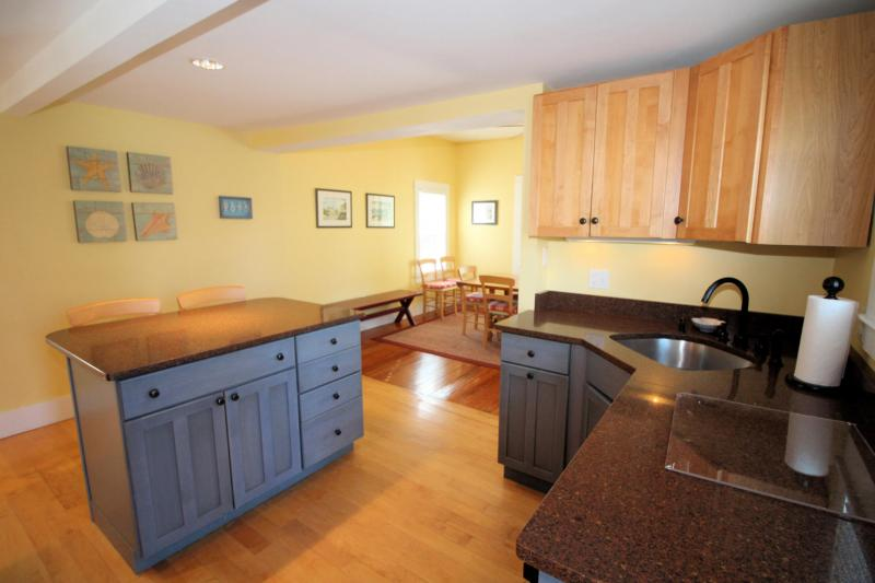Kitchen is bright and opens to dining room