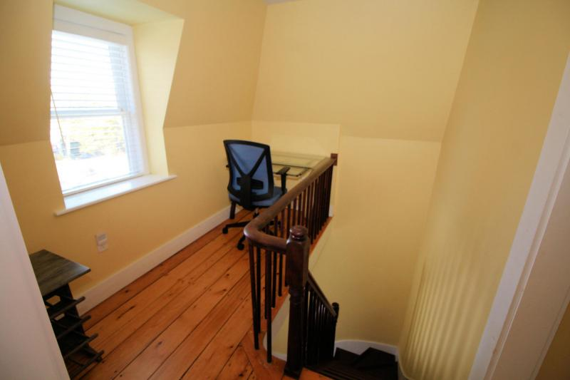 Alcove with desk at top of front stairs
