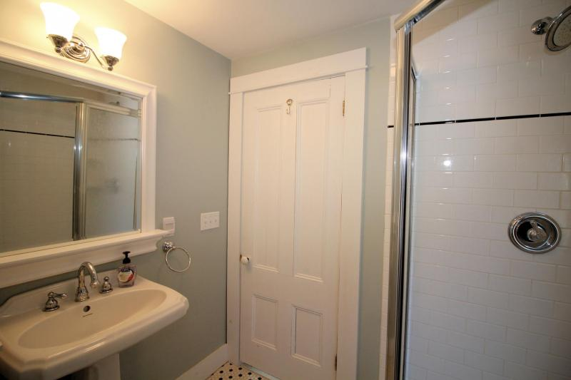 Second floor bathroom with shower stall