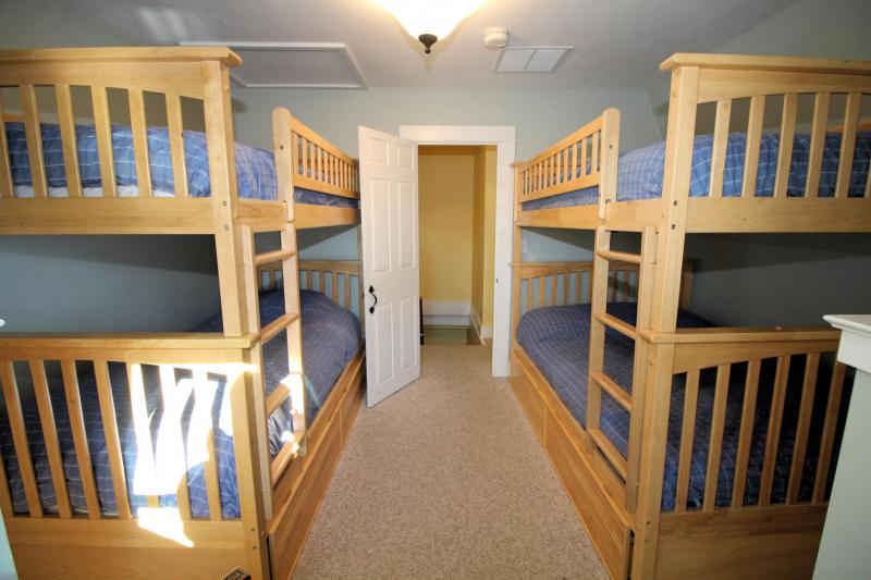 Second floor bedroom with two bunk beds