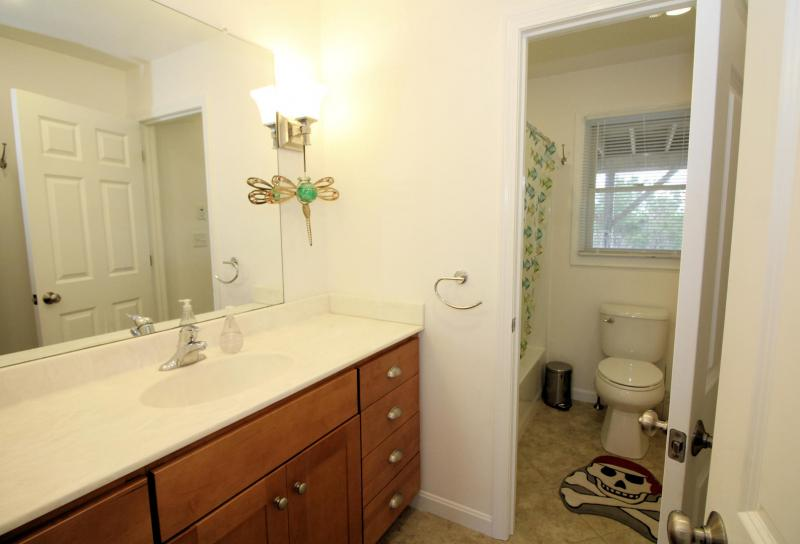 Firsit floor bathroom with tub and shower