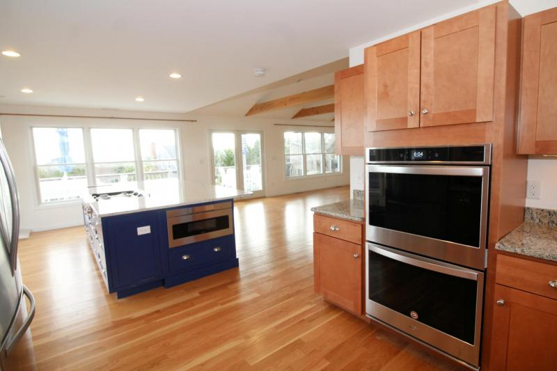 Kitchen island opens to dining area and deck