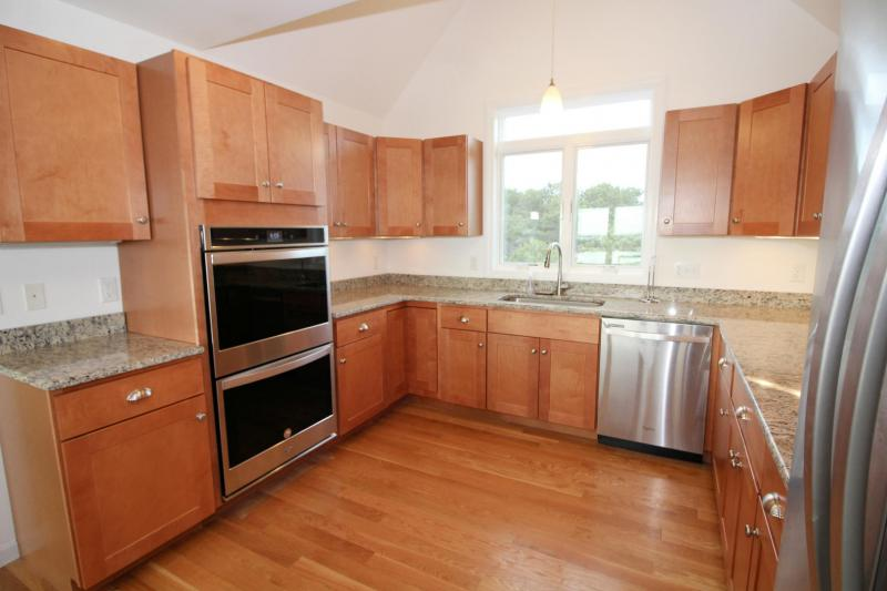 Kitchen with stainless appliances including a double wall oven