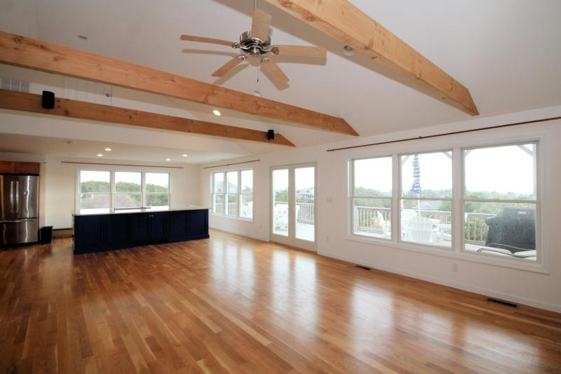 Beautiful open dining area and kitchen with doors to deck