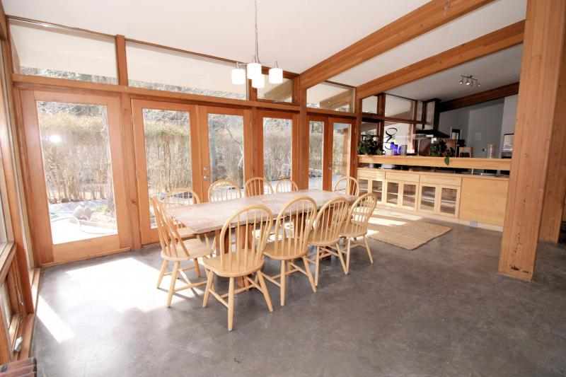 Dining area with doors to deck