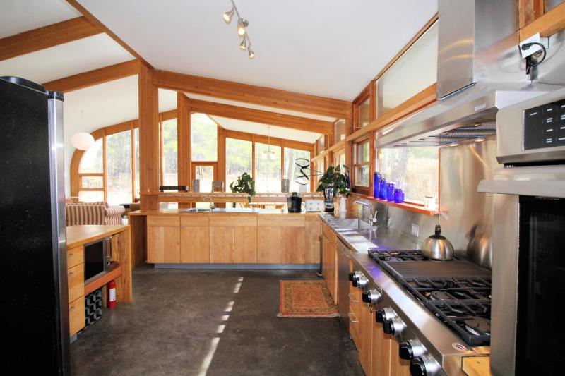 Kitchen has a commercial range and wall oven