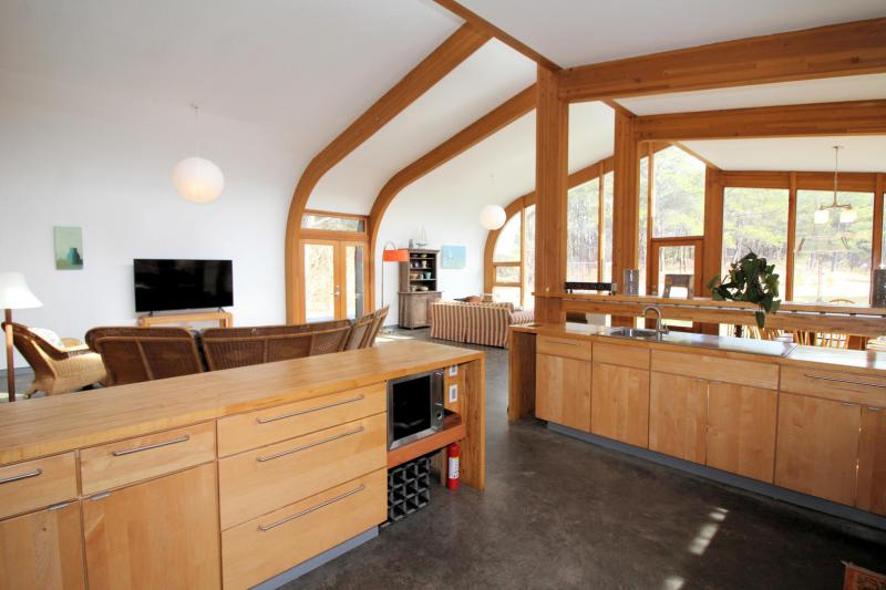 Kitchen has plenty of counter space and a wine cooler