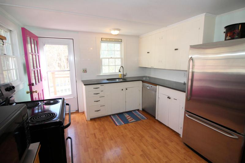 Kitchen has granite counter tops and stainless appliances