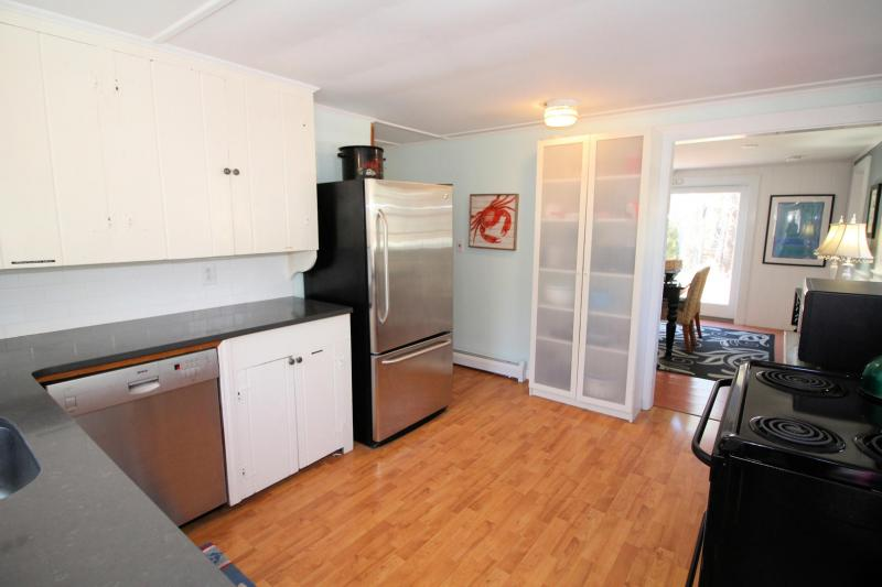 Kitchen opens to hall and dining area