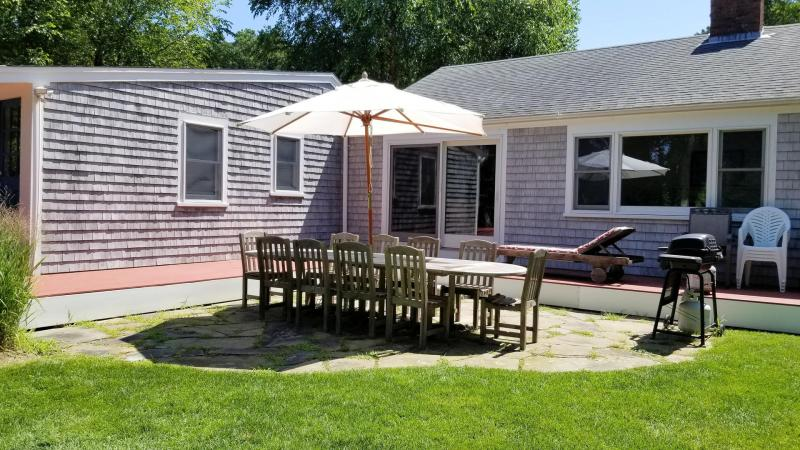Lovely patio with outdoor furniture and gas grill