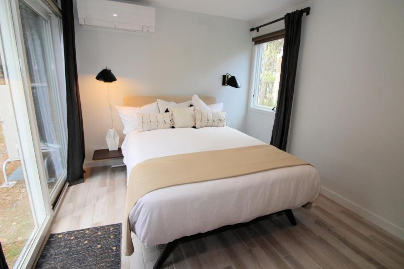 Bedroom with queen bed and slider