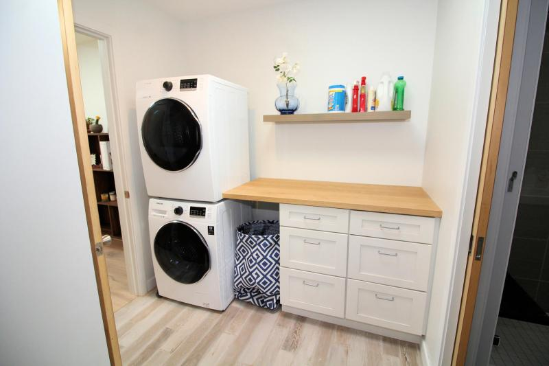 Washer and dryer in hall near bathroom
