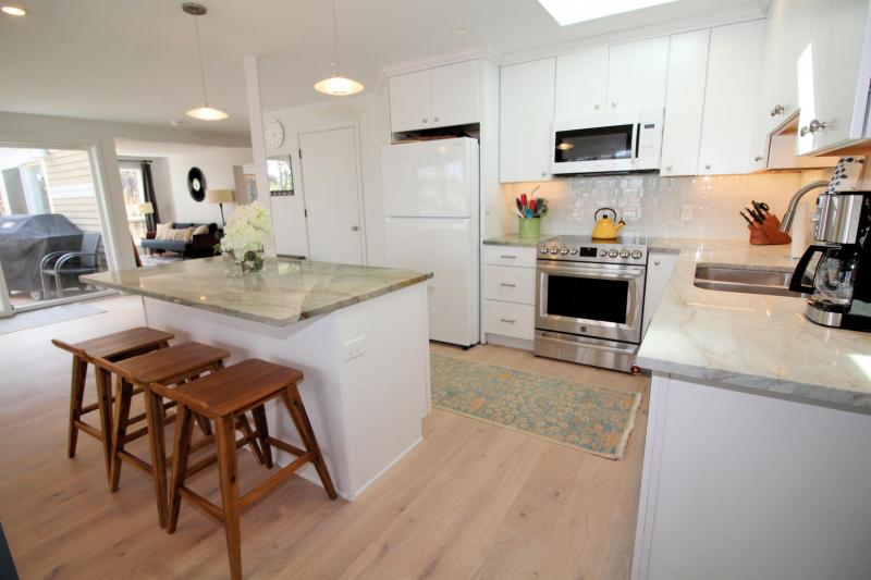 Well equipped kitchen has beautiful granite counter tops