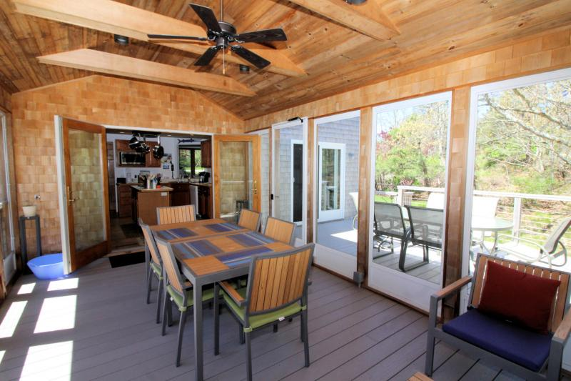 Screened porch opens to kitchen and deck