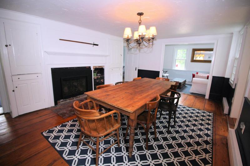 Separate dining room with large table