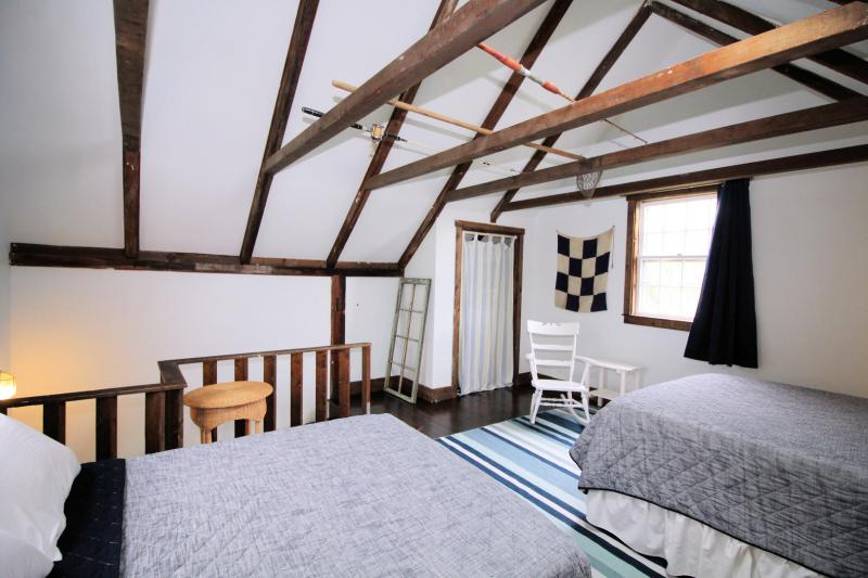 Second floor bedroom in cottage is spacious and open