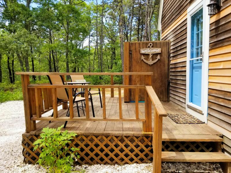 Encosed outdoor shower and bistro table on smaller deck