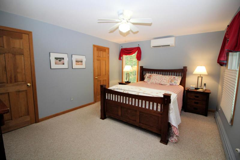 First floor master bedroom with queen bed and ensuite bathroom