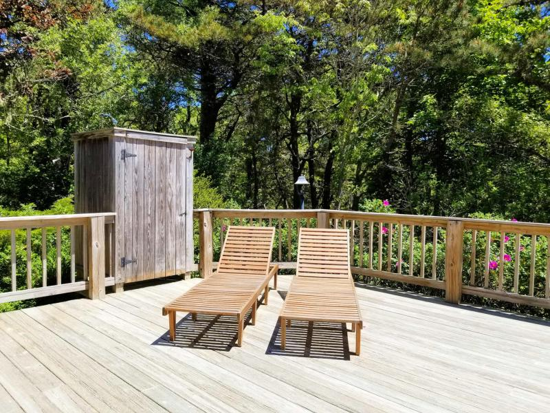 Chaisse lounges and outdoor shower on the deck
