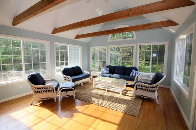 Wonderful sunroom with slider to deck