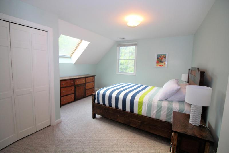 Second floor bedroom with queen