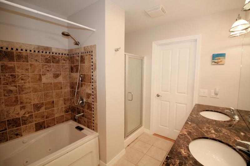 Bathroom with two sinks and separate tub and shower