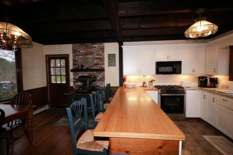 Eat in kitchen with large dining table and breakfast bar