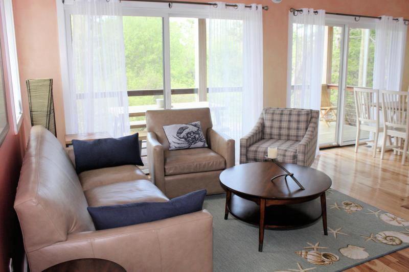Comfortable living room with slider to deck