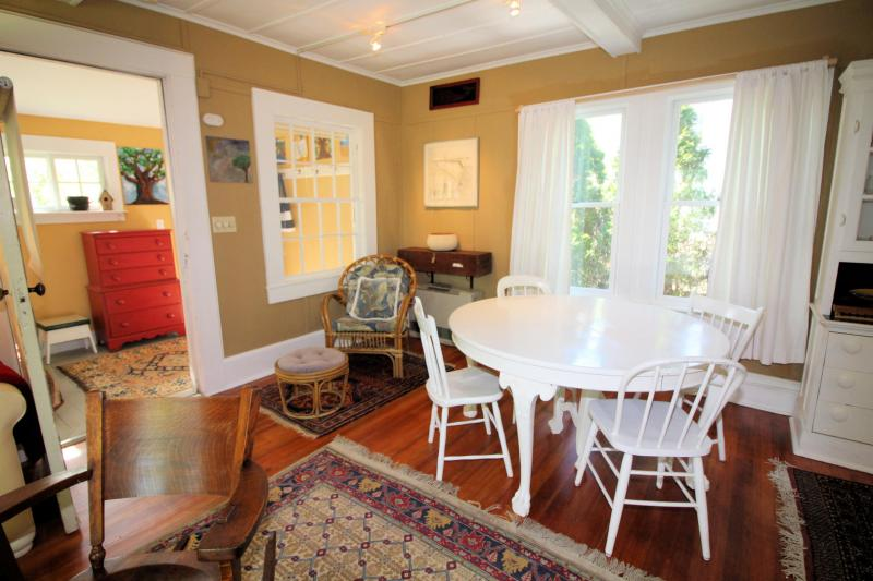 Living area is open to dining area with table and chairs