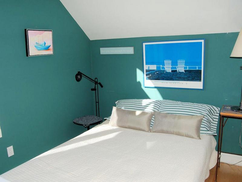 Second floor bedroom with double bed and views of bay