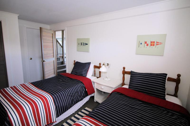 Lower level bedroom with two twins