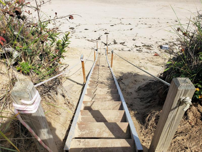 Stairs to shared private beach