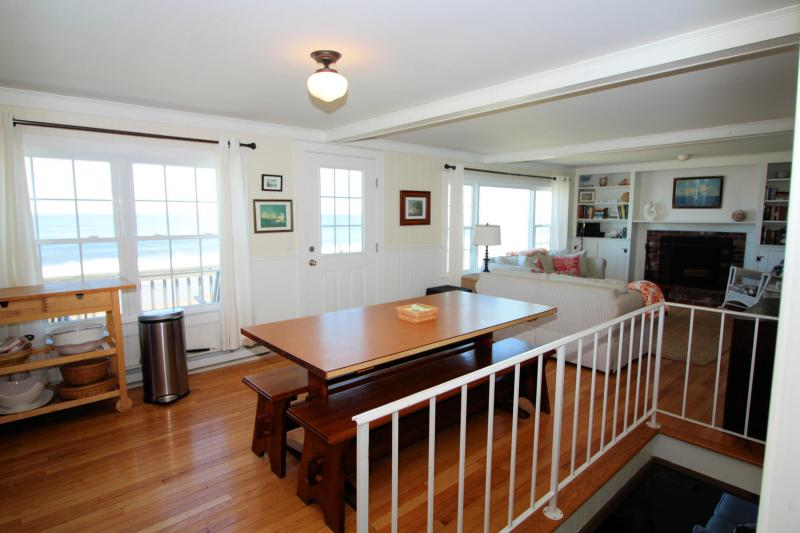 Open dining and living area with stairs to lower level