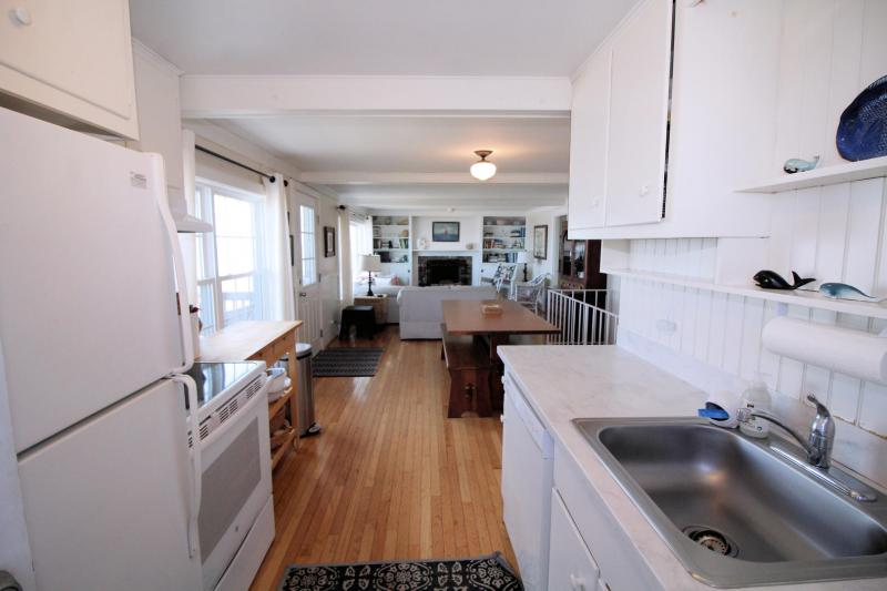 Nicely equipped kitchen opens to dining area