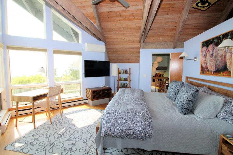 Master bedroom with king bed and balcony deck