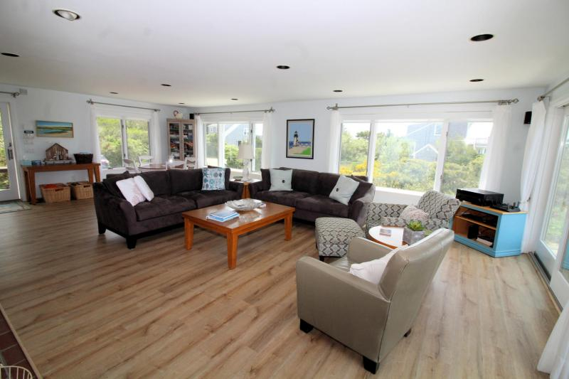 Open and bright living room has comfortable seating