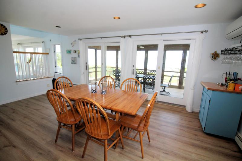 Sliders lead to lovely screened porch