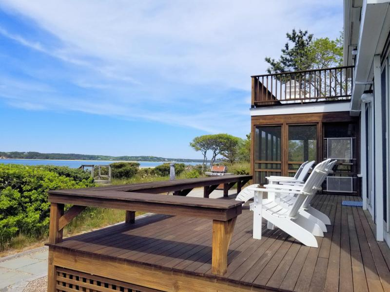 Wonderful deck and screen porch overlook the water