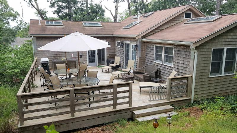 Spacious deck with furniture and grill