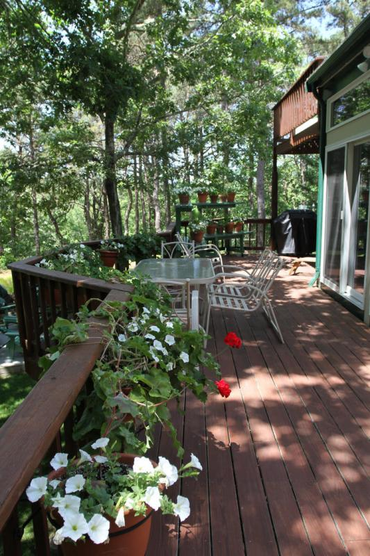 Large deck overlooks the beautiful green yard