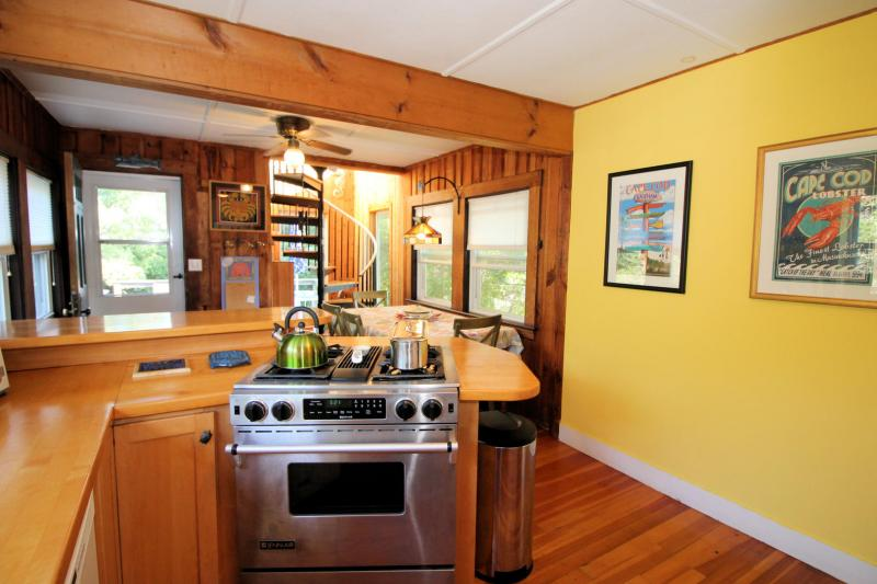 Nicely equipped kitchen with door to deck