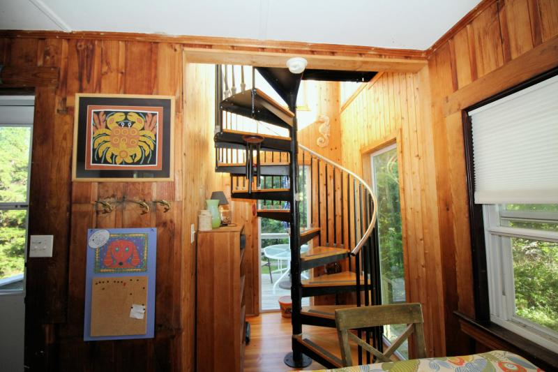 Spiral staircase leads to second floor master bedroom