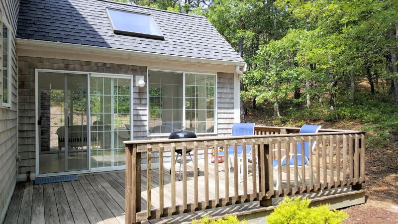 Sunroom with slider leads to deck