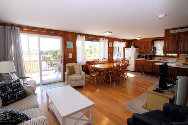 Living and dining area with slider to deck