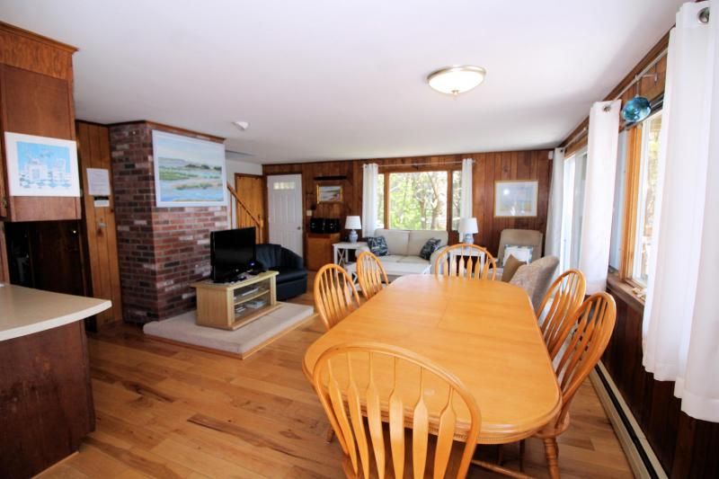 Large dining table with living room beyond